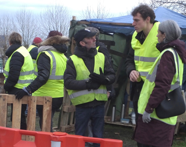 Yellow vest protesters at roadblock in Dieppe in Normandy region of France Dec. 10. From right is U.K. Communist League member Debra Jacobs and area worker Arnold, who organized League members' visit to join protesters and meet workers and farmers in area.