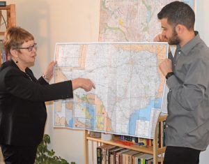 Alyson Kennedy, SWP candidate for Dallas mayor, and campaign supporter Samir Hazboun show on maps where they will campaign around the state as they also get on ballot in Dallas.