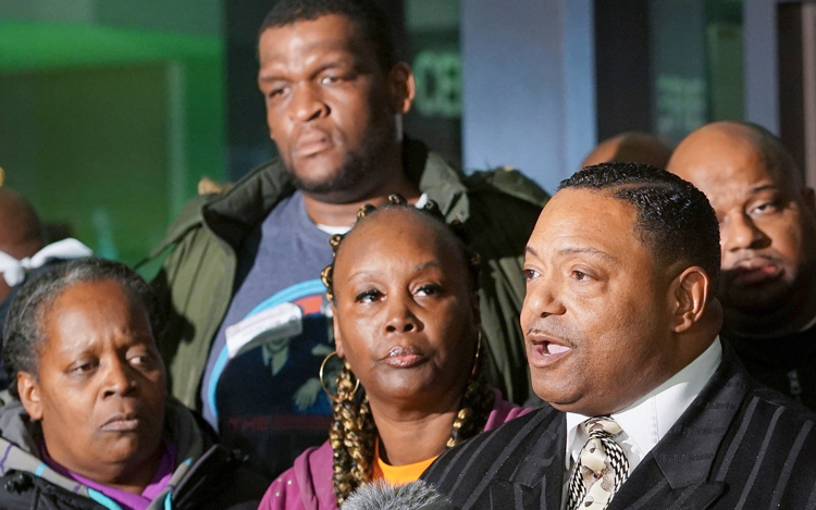 Right, Rev. Marvin Hunter, uncle of Laquan McDonald killed by Chicago cops in 2014.
