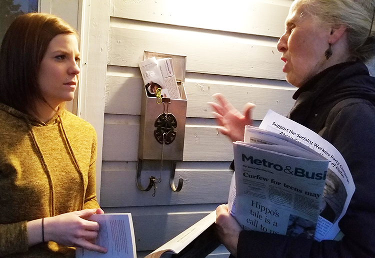 """I'm probably a socialist, too,"" Katelyn Galbreath told Socialist Workers Party campaigner Sarah Ullman, right, after they talked when Ullman knocked on her door in East Dallas, Jan 17."