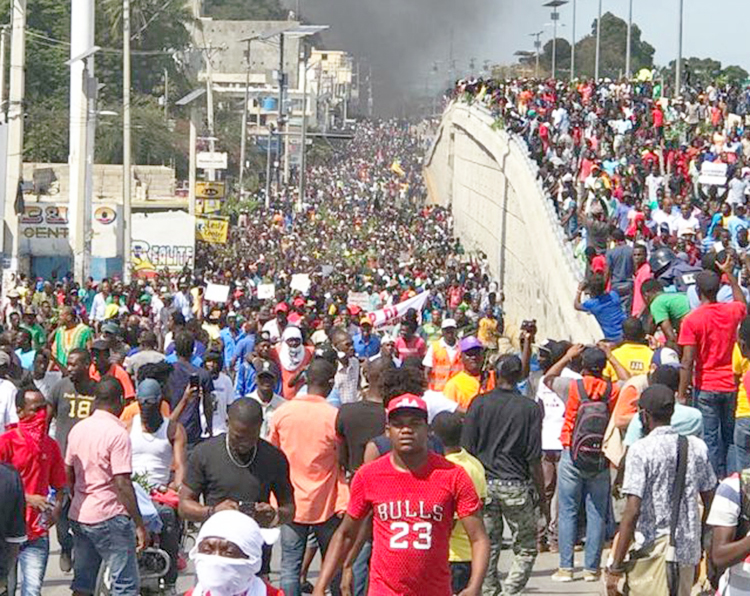 Haitian working people gather in Port-au-Prince Feb. 7 demanding President Jovenel Moise resign. Protests were triggered by soaring inflation, youth joblessness and rampant corruption.
