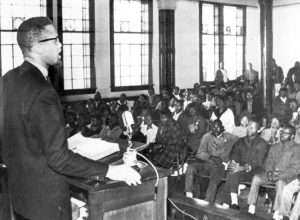 Malcolm X speaks to young civil rights fighters in Selma, Alabama, Feb. 4, 1965. In last weeks of his life, Malcolm spoke increasingly as a revolutionary leader of the entire working class.