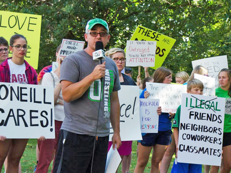 Rally in O'Neill, Nebraska, Aug. 8, 2018, protesting arrest and deportation of workers without papers at nearby factories and farms. The source of anti-immigrant prejudice is not the working class, Róger Calero notes, but the bosses, who benefit from discrimination.