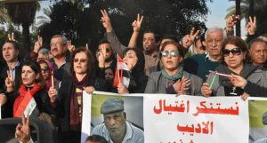 "Top, ""There is a struggle going on between the U.S. and Iran, and it is taking place on Iraqi soil,"" Adel Hatem told speakout at Baghdad's Al-Qushla fort Feb. 8. Below, protest against murder of novelist Alaa Mashzoub, known for opposition to foreign intervention, Feb. 6, sponsored by writers' union."