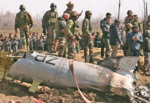 Indian soldiers survey wreckage of air force helicopter in Budgam, Kashmir, Feb. 27, during renewed military friction between rulers of India, Pakistan. Six airmen died in the crash.