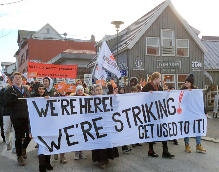 March 8 International Women's Day protest by hotel workers in Reykjavik, Iceland, as part of a one-day strike demanding higher pay, affordable housing and a shorter workweek.