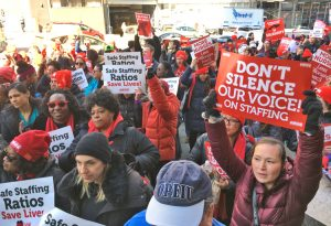 Hundreds of nurses rally March 18 at Mount Sinai Hospital, as New York nurses fight for new contract at major hospitals in city. Demands include more nurses to provide care.