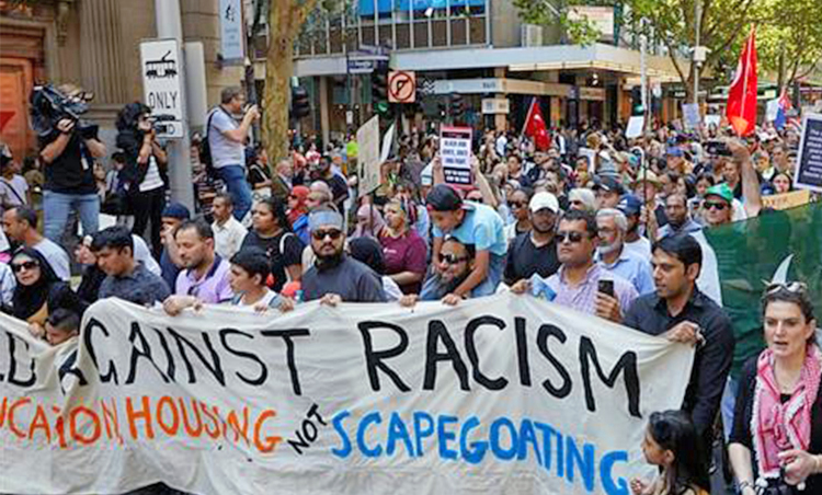 March 16 march in Melbourne, Australia, protesting anti-immigrant lone gunman's armed assault on worshippers attending services at two mosques in New Zealand that killed 50.