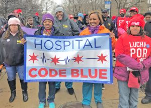 Hospital workers and supporters demonstrate outside Mt. Sinai Hospital in Chicago March 20 for higher wages, more staffing and to back nurses' fight to organize a union.