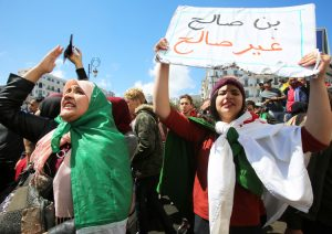"Protesters in Algiers April 9 demand removal of entire government after Algerian President Abdelaziz Bouteflika was replaced by Abdelkader Bensalah. Placard reads, ""Bensalah, not fit."""