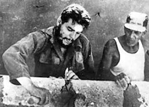 "Che Guevara leading voluntary work in Cuba, early 1960s. ""In this period of the building of socialism we can see the new man and woman being born,"" Che said. This process continually develops, he said, ""hand in hand with the development of new economic forms."""