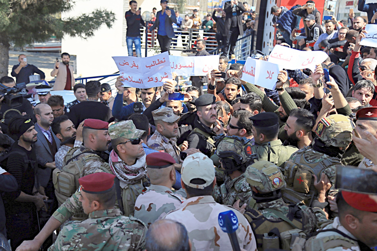 "Angry relatives of over 100 killed in sinking of ferry blocked road chanting ""no to corruption"" when Mosul's governor arrived March 22. Victims had been celebrating New Year's holiday."