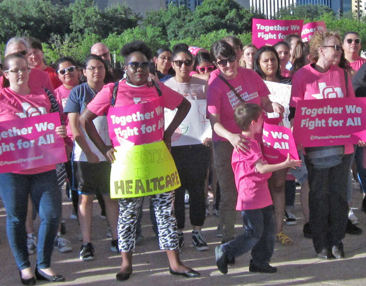 Supporters of access to safe and secure family planning, including abortion, rally in Dallas May 21, one of hundreds of protests this week of tens of thousands across the country.