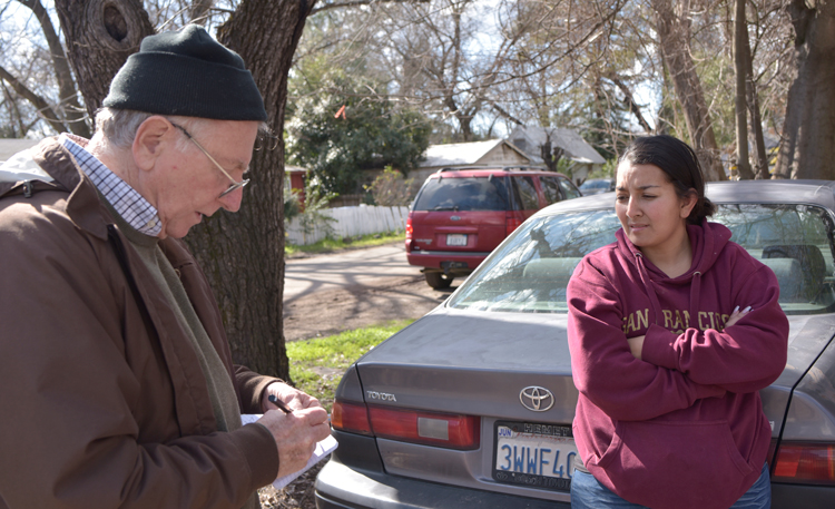 Bianca Alvarado, right, talks with Jeff Powers in Chico, California, in February after wildfire destroyed nearby Paradise, killing scores. Fire was caused by PG&E bosses' disdain for safety.