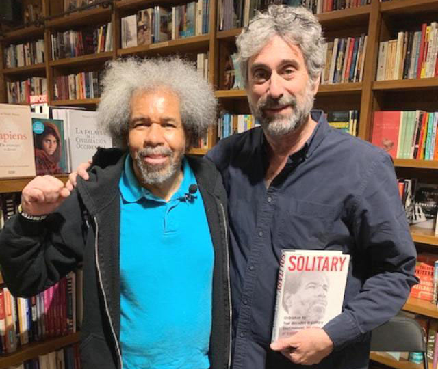 "Albert Woodfox, left, with Books and Books owner Mitchell Kaplan May 16. Almost 100 people jammed into Miami bookstore to hear Woodfox speak on his book Solitary: My Story of Transformation and Hope. Florida prison censors have tried to block the Militant from reaching inmates with his story, claiming it will ""lead to the use of physical violence."""
