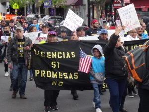 "Marchers in Perth Amboy, New Jersey, chanted ""Licenses yes, promises no"" on May Day. Handmade signs were everywhere. For many it was their first time joining a protest action."