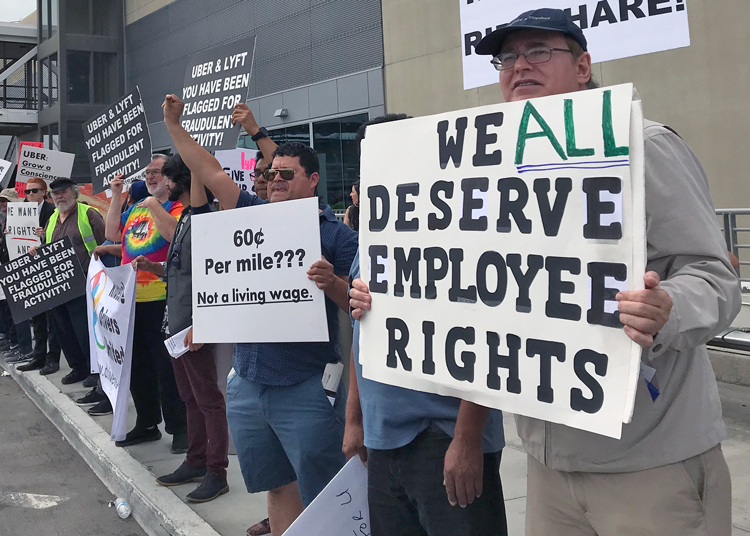 "As part of national strike, Uber and Lyft drivers in Los Angeles shut off their apps for 24 hours May 8 and picketed at the airport. ""We're fighting for living wages,"" driver Karim Bayumi said."