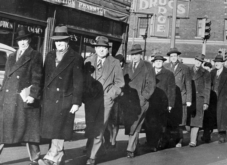 James P. Cannon, second from left, and other convicted members of Socialist Workers Party and Teamsters union march in Minneapolis, 1943, to begin prison sentences for organizing opposition to U.S. entry into WWII. Cannon led fight to lead SWP deeper into industrial unions.