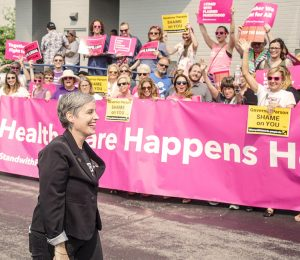 Crowd greets May 31 restraining order against closing of Missouri's only family planning clinic providing abortion. In foreground, Missouri Planned Parenthood officer M'Evie Mead.