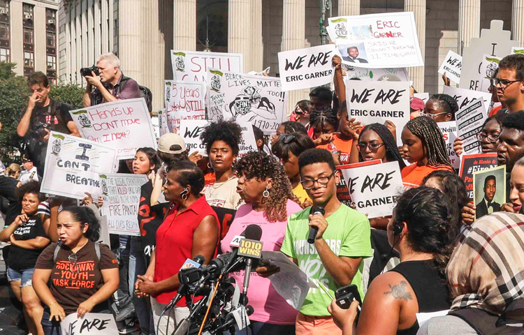 New York rally July 17 after federal government refused to press charges against cop who killed Eric Garner. Gwen Carr, Garner's mother, at center, vowed to continue to fight for cop's firing.