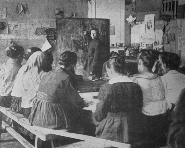 "Women attend literacy class in Soviet Union in early 1920s during Russian Revolution. ""A radical reform of the family, and of the whole order of domestic life, "" Leon Trotsky writes,"" requires a great conscious effort on the part of the whole mass of the working class."""