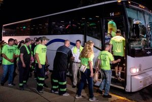 "Miners in Harlan County, Kentucky, get on bus to attend Blackjewel Coal bankruptcy hearing Aug. 5 in Charleston, West Virginia, wearing T-shirts saying ""Pay the miners first, lawyers last."""