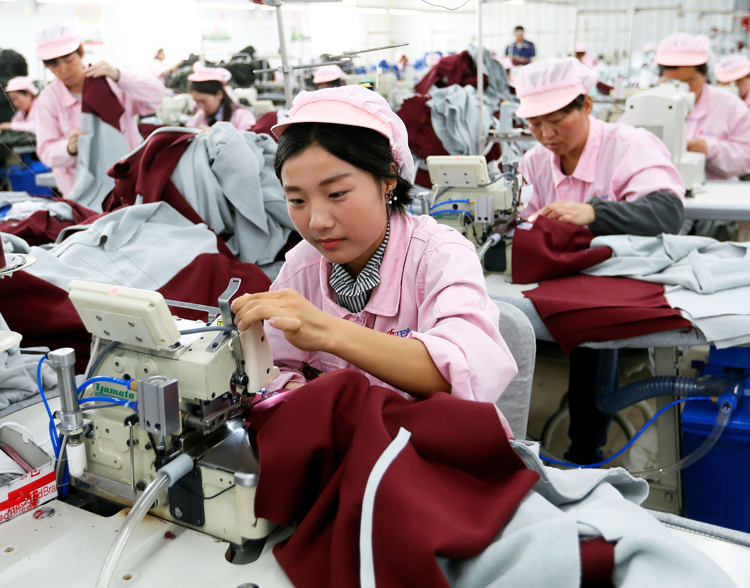 "Garment workers in Heze, China, in 2018. The industrial workforce is ""the class that is the foundation and special product of capitalism,"" writes SWP leader George Novack. It is also ""destined to take charge of the economy and remodel society from top to bottom."""