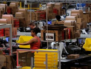 Workers at Amazon fulfillment center in Robbinsville, New Jersey, November 2017. Competition between retail giants drives bosses' assaults on workers who face job cuts and low wages.