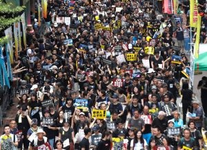 Throngs fill streets in peaceful protest in Hong Kong Aug. 18 in largest action in two months.