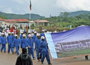 Workers in Equatorial Guinea at Chinese-run construction project march at Oct. 12, 2005, independence day parade in Evinayong. Growth of oil industry has expanded the capitalist class and above all, a working class that has growing self-confidence, pride and a widening scope.