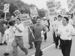 Dakota Premium meatpacking workers march and rally in St. Paul, Minnesota, in June 2000 during fight that won a union and workers' right to monitor line speed in the plant.