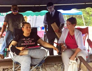Touring Socialist Workers Party militants Alyson Kennedy, bottom right, and Malcolm Jarrett, top right, talk with Chris and Stacy Rowe at miners' encampment in Cumberland, Kentucky.