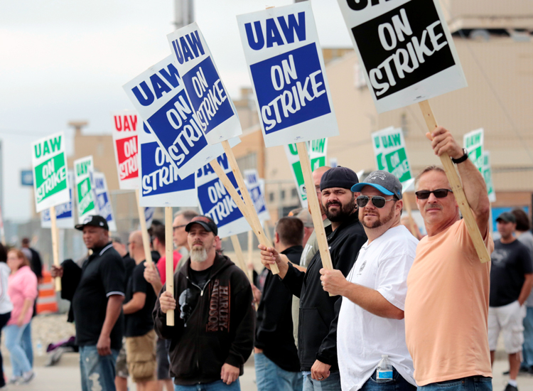 Autoworkers picket in Flint, Michigan, Sept. 16. Strike shut down 33 plants, 22 warehouses.