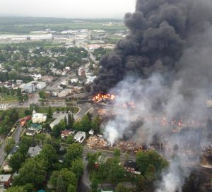 July 6, 2013, day of train derailment in Lac-Mégantic, Quebec, that killed 47 people. Upper left is Tafisa, largest particle board plant in North America. Plant depends on tracks that were rebuilt through center of town weeks after explosion and fire, while town center was razed.