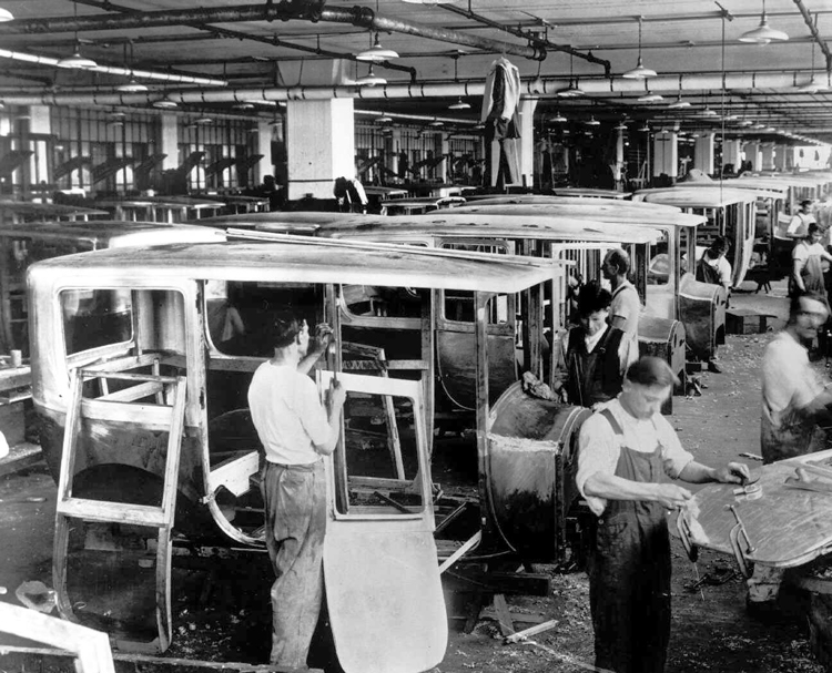 "Workers fit cars at Packard plant in Detroit in 1920s. Trotsky says the expansion of U.S. imperialism transformed it ""into the basic counterrevolutionary force of the modern epoch,"" and ""prepares the ground for a gigantic revolutionary explosion in this already dominant"" power."