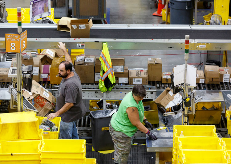 Workers at Amazon warehouse in Chattanooga, Tennessee, 2017. Retail rivals Walmart and Amazon are ramping up the pressure on workers as they compete for ever faster deliveries.
