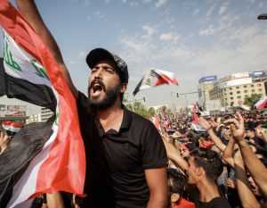 Protesters in Baghdad Oct. 1, one of many actions across southern Iraq. Working people have used opening of political space with the defeat of Islamic State to press demands for jobs, services, for the fall of the government and for Tehran's hated militias to leave the country.