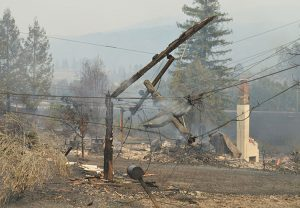 Burned, mangled power lines in Santa Rosa, California, Oct. 2017. PG&E faces millions of dollars in damages over responsibility for fire for poor maintenance, failure to clear vegetation.