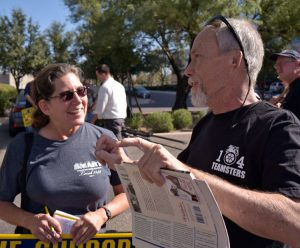 SWP member and rail worker Deborah Liatos speaks with Asarco striker Jim Wagener at Nov. 18 rally in Tucson, Arizona. He got a Militant subscription and In Defense of US Working Class.