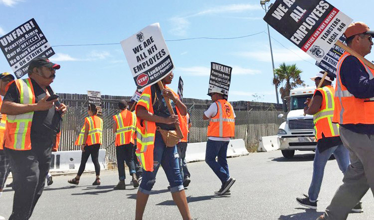 """Truck drivers picket in Wilmington, California, Sept. 9, demanding NFI company bosses treat them as workers, not """"contractors."""" Farrell Dobbs explains how owner-operators, loaded by debt, are also exploited workers."""