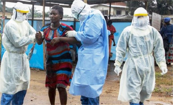 Cuban internationalists aid Ebola patient in Liberia in 2015. Some 250 Cuban volunteer doctors, nurses and other health workers led successful 2014-15 fight to end epidemic in West Africa.