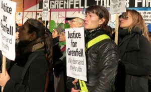 "Demonstrators protest Nov. 14 in London in one of monthly ""silent marches"" marking 2017 fire in Grenfell Tower where 72 people died after flammable cladding on building ignited."