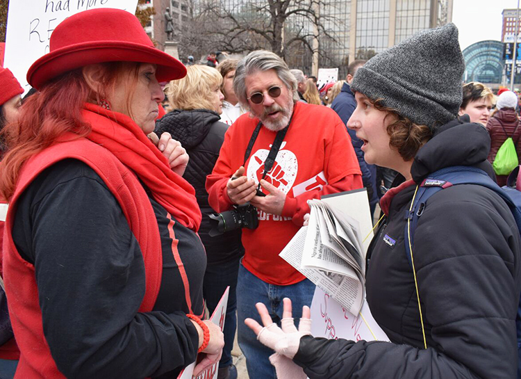Socialist Workers Party member Kaitlin Estill, right, speaks with art teacher Diana Sale at rally of over 12,000 in Indianapolis Nov. 19 backing teachers' fight for pay raise, smaller class sizes.