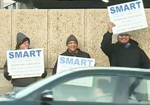 Members of rail union SMART Transportation Division Local 1409 picket in downtown Kansas City, Missouri, Nov. 5, protesting rail bosses' layoffs that threaten workers' safety.