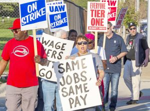 GM workers gained confidence during the strike, standing together and building unity in fight for equal pay for equal work. Above, Sept. 18 UAW picket at Detroit-Hamtramck plant.