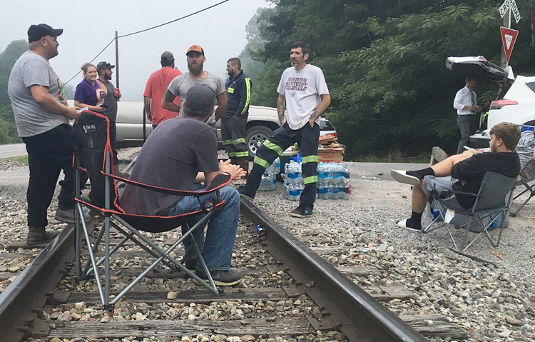 Miners block rails, Harlan County, Kentucky, July 2019, to stop Blackjewel bosses from hauling coal until wages owed them were paid. The nonunion miners won broad support and, in October, their back pay.