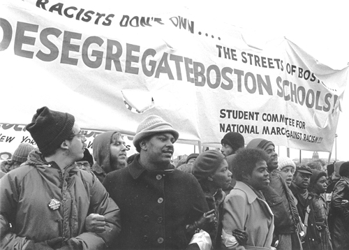 """December 1974 march in Boston to support school desegregation. Mass meetings, protests and defense of school buses beat back attacks organized by Democratic Party leaders. Battle was a """"decisive combat experience for an entire layer of the party leadership,"""" Barnes says."""