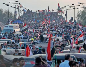 Demonstrators in Iraq block Joumhouriya bridge in Baghdad Nov. 3. Protesters demand end to government's refusal to provide jobs, electricity, and an end to Tehran's ongoing intervention.