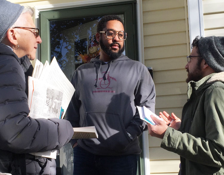 Jerion Evans gets The Turn to Industry: Forging a Proletarian Party by SWP National Secretary Jack Barnes, from Maggie Trowe, and Samir Hazboun, right, in Louisville, Kentucky, Nov. 9.