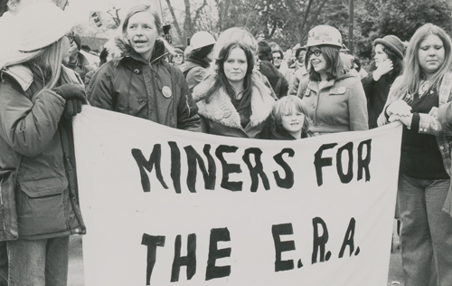 Left, unionists across U.S. joined march of 5,000 in Austin, Minnesota, April 1986, to back UFCW Local P-9 against Hormel. Above, UMWA contingent in labor march for Equal Rights Amendment, Richmond, Virginia, January 1980. Leaders of Coal Employment Project, which helped women get mining jobs, hold banner. Right, Ed Sadlowski, Steelworkers Fight Back candidate for union president, speaks at Detroit rally, Feb. 5, 1977. Ranks used campaign to seek control over their union and end to USWA officials' connivance with steel bosses.